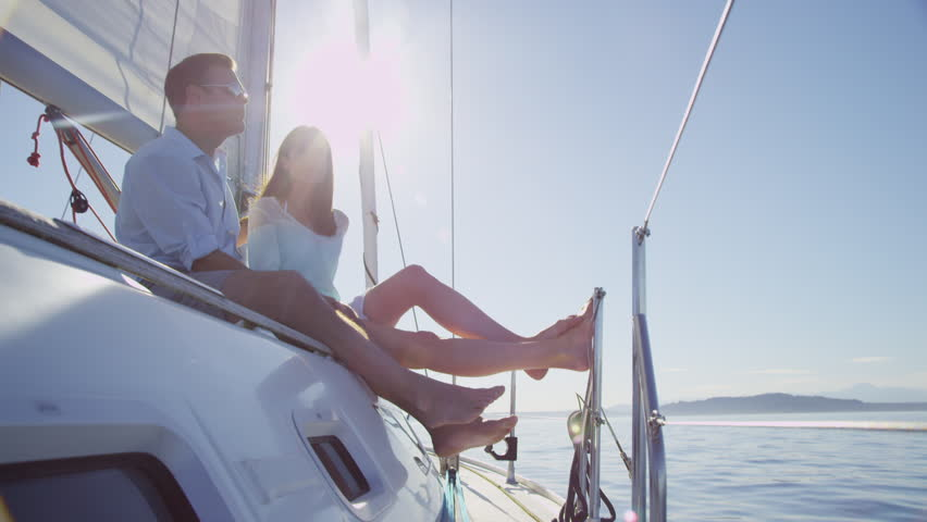 Couple relaxing together on Sail Boat, Seattle, WA