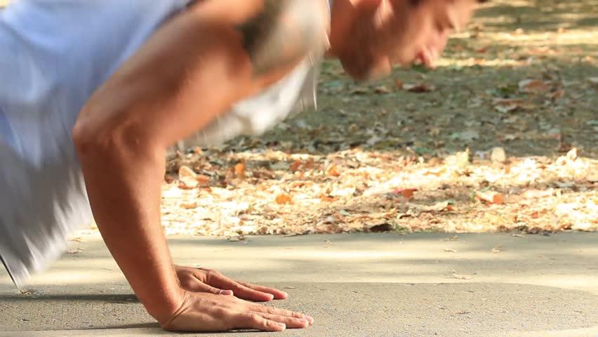 The guy doing push-ups, close up shot.