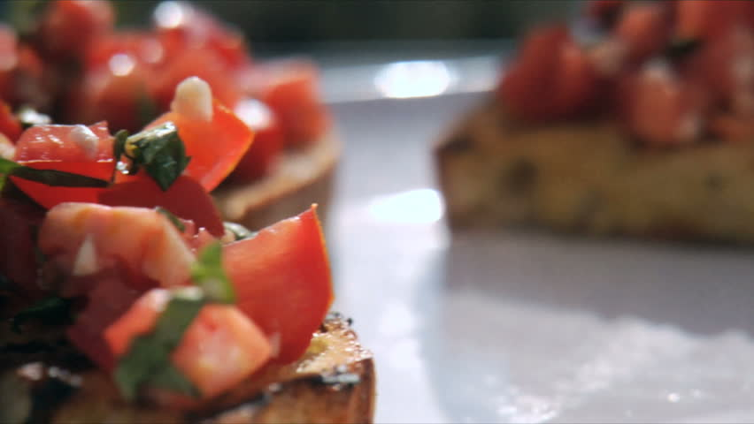 Close up of bruschetta tomato and onion on toasted bread for Wooden canape trays