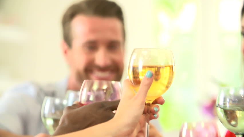 Close up view of friends toasting wien glasses together at dinner party slow motion view - HD stock footage clip