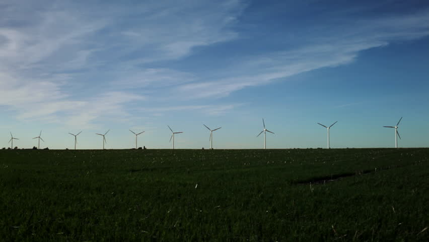 Wind turbines create renewable energy in the rural Usa countryside pictures