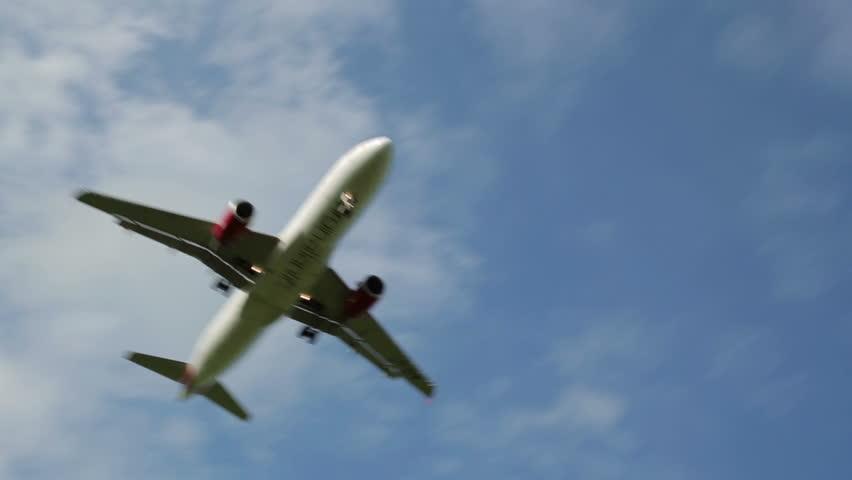 MANCHESTER, LANCASHIRE/ENGLAND - SEPTEMBER 29: Virgin Atlantic plane flies overhead to land on September 29, 2013 in Manchester. Virgin Atlantic is owned by Sir Richard Branson's Virgin Group.