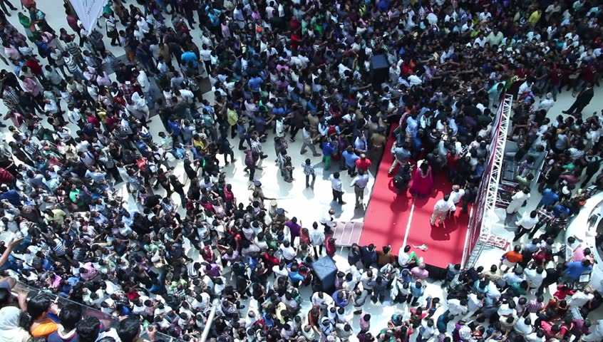 Crowded shopping at mall in India. crazy crowd running behind a celebrity. Unusual. Commuters aerial view.