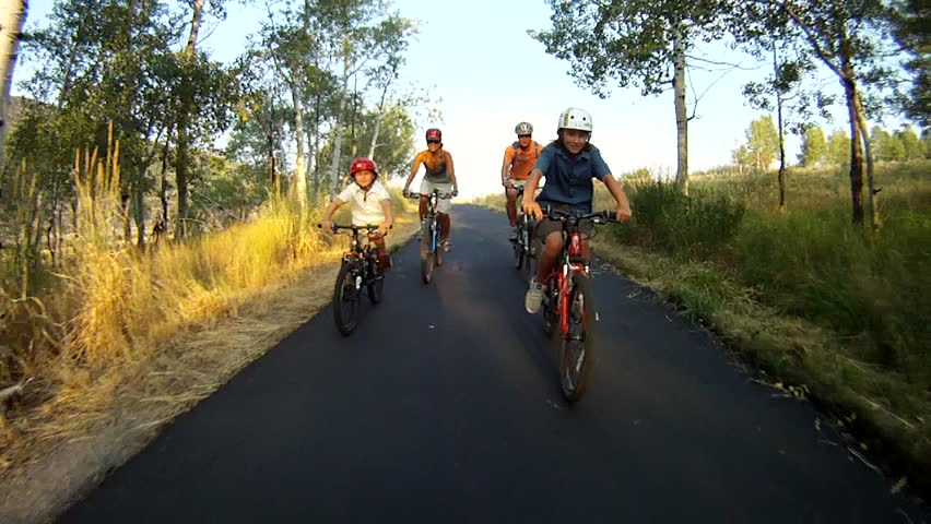 Family mountain biking on paved trail, Park City, Utah.