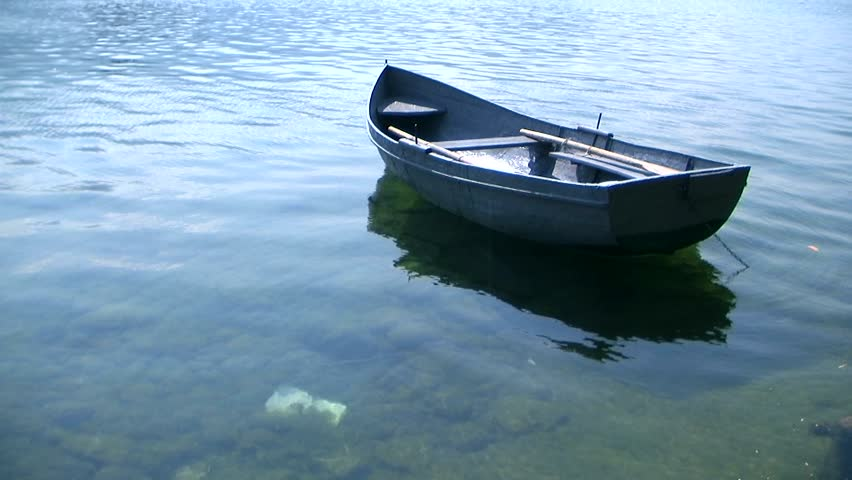 Small Fishing Boat Floating On The Water Hd Stock Video Clip
