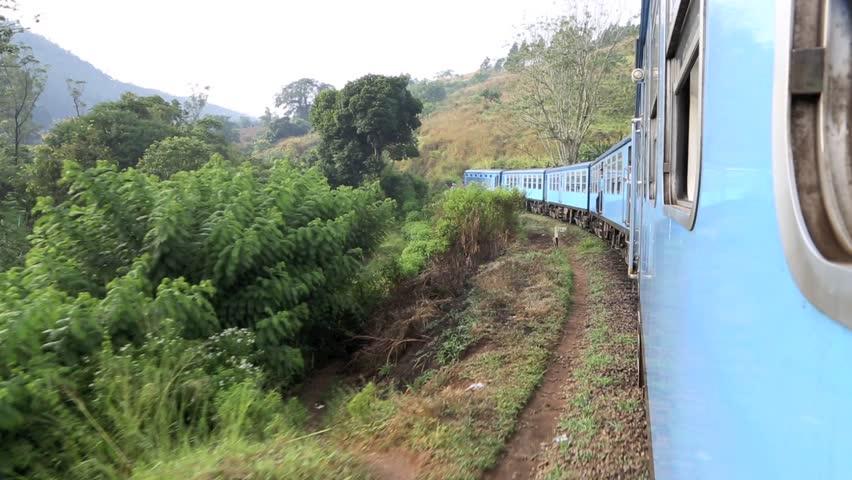 ELLA, SRI LANKA - OCTOBER 18: Passenger train in scenic countryside on October 18, 2013 in Ella, Sri Lanka