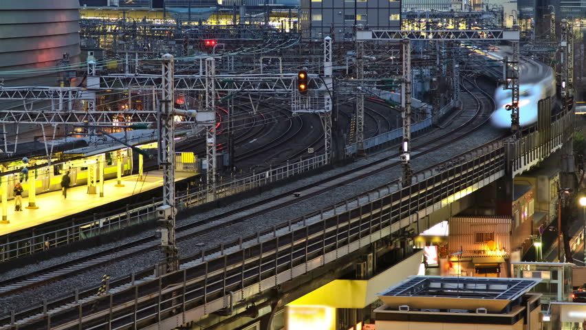 Time lapse of Ginza Tokyo train station and trains.