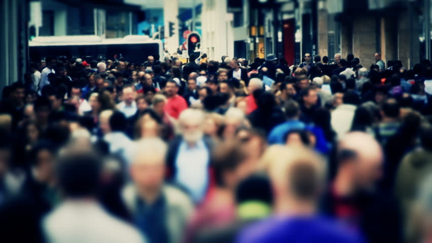 City pedestrian traffic shot on a busy Brussels shopping street with added color correction.