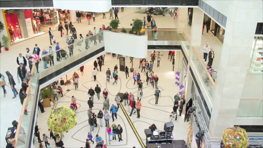 Slightly defocused crowd of walking people in the newly opened shopping mall center