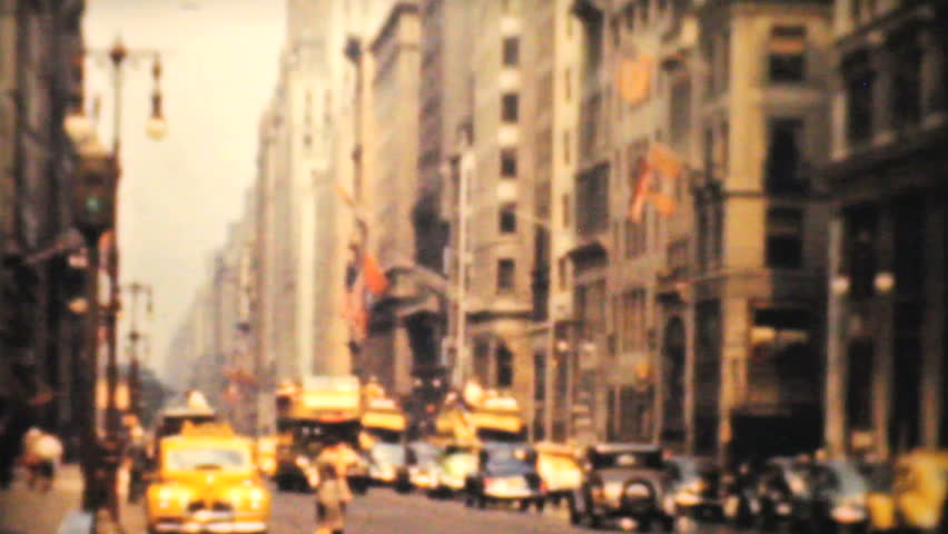 NEW YORK, NEW YORK, 1940: A shot of busy downtown New York at Fifth Avenue including a tour bus passing by in 1940.