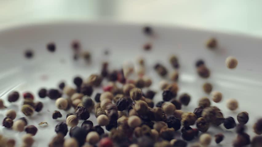 Peppercorns falling