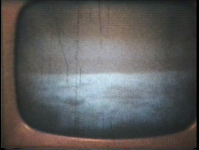 "MOON - JULY 20. 1969: Neil Armstrong and Buzz Aldrin's famous ""moon walk"" in July 1969 as seen through an old television film with an 8mm camera.  (1969 - vintage 8mm film footage)"