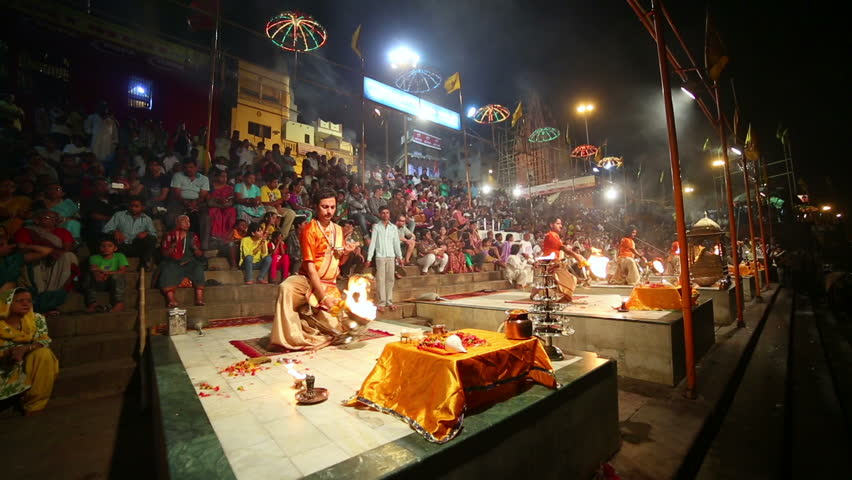 VARANASI, INDIA - MAY 2013: Night scene with religious praying ceremony by Ganges River in Varanasi, India