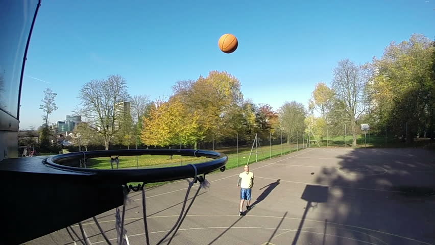 Basketball player shooting a 3 point jump shot in slow motion and scoring - HD stock video clip