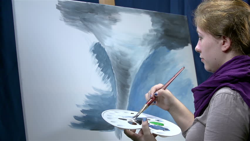 Woman drawing tornado with watercolors on canvas - HD stock footage clip