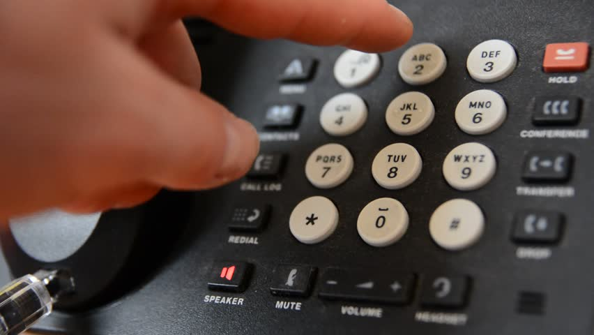 Finger is pushing the phone number buttons and pick up the earphone. - HD stock footage clip
