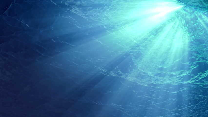 High quality Looping animation of ocean waves from underwater with floating plankton. Light rays shining through. Great popular marine Background. (seamless loop, HD, high definition 1080p)