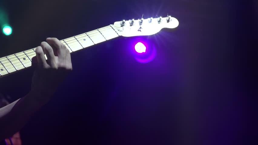electric guitar on stage slow motion at a rate of 240 fps guitarist holding guitar fretboard. Black Bedroom Furniture Sets. Home Design Ideas