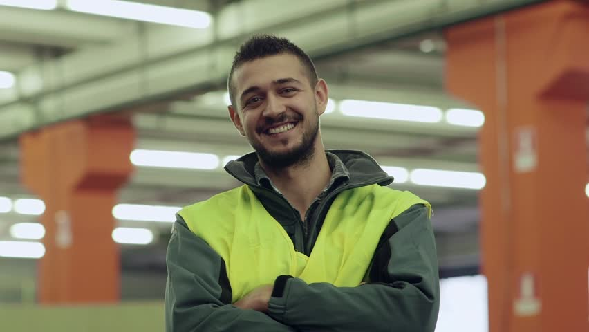 Portrait of happy young man employed in logistics facility smiling at camera, people working in warehouse, workers in industry. 15of19