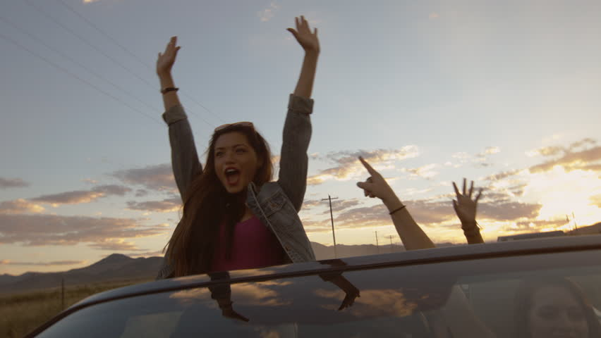 Teen Stands, Raises Her Arms & Yells In A Convertible To Celebrate w/Friends