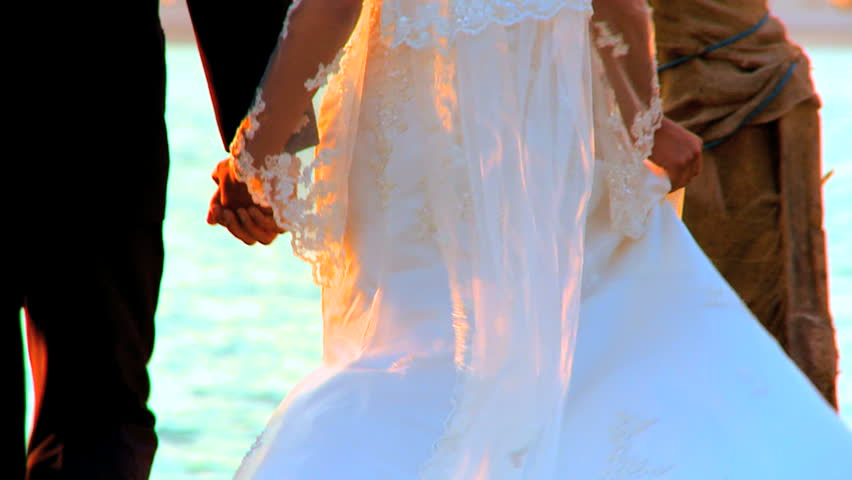 Young Couple Walking Beach Side After Their Tropical Wedding Ceremony Stock Footage Video 531184