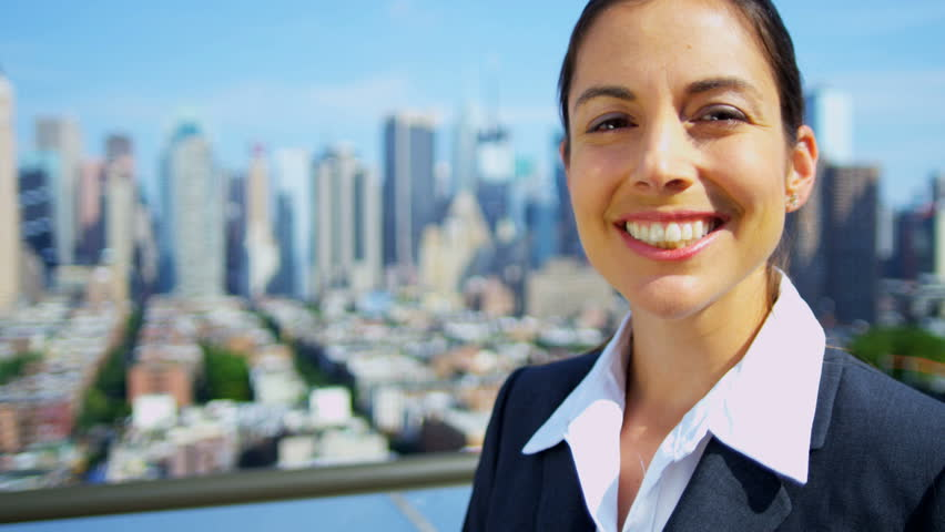 Portrait of successful Caucasian businesswoman on rooftop overlooking Manhattan shot on RED EPIC, 4K, UHD, Ultra HD resolution - 4K stock video clip