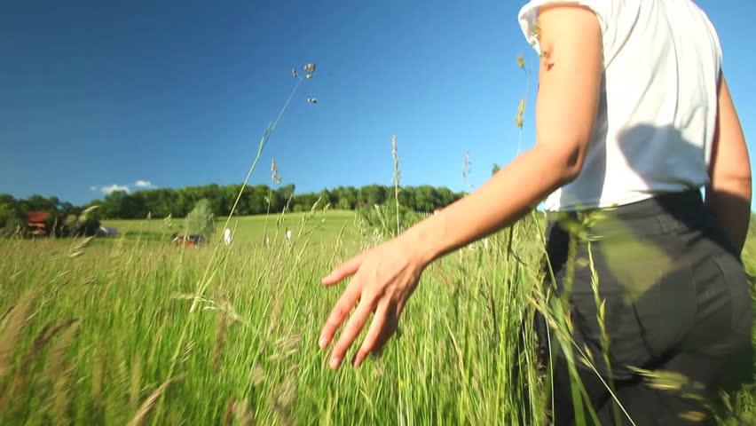 woman walking in grass - photo #24