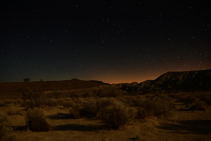 4K Astro Time Lapse of Moon Shadow Sweeping Desert Landscape