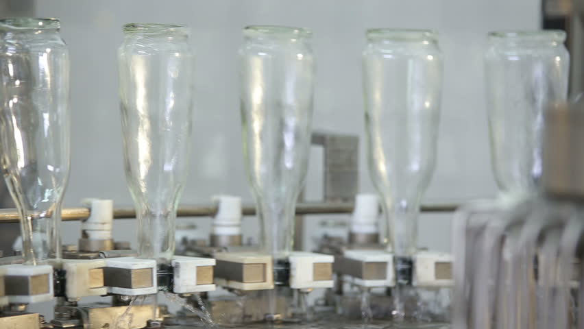 bottles of cognac upside down - HD stock video clip