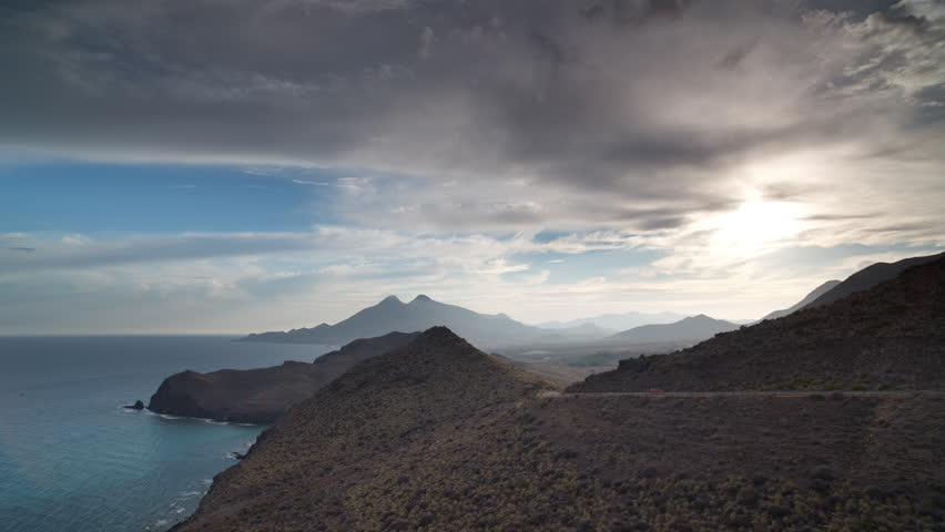 4k Time lapse looking out to sea with mountains in the background on a beautiful afternoon in, cabo de gata, spain