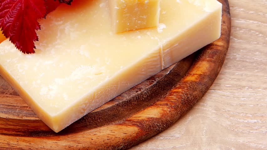 various types of cheese on wooden platter over wooden table 1920x1080 intro motion slow hidef hd