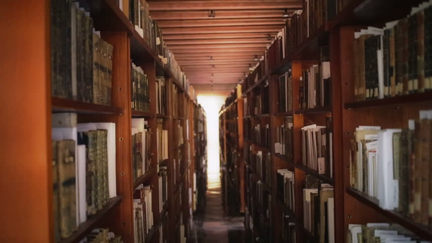 Long hall of library with wooden bookcases
