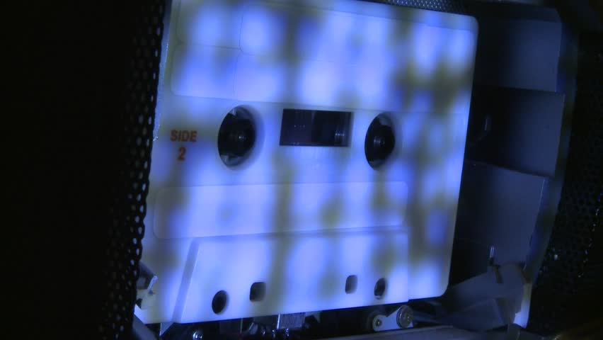 Music recording taping playing cassette tape in machine player with special effect lighting 1080 1920x1080 stock video footage clip