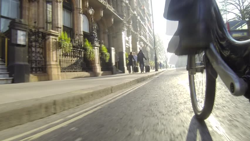 """LONDON, UK - JANUARY 21, 2014: Bicycling in London using city rental bikes (also known colloquially as """"Barclays bikes"""" or """"Boris bikes""""). Pov. - HD stock footage clip"""