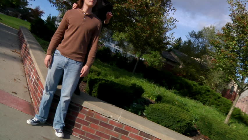 A dating couple frolics on campus. - HD stock video clip