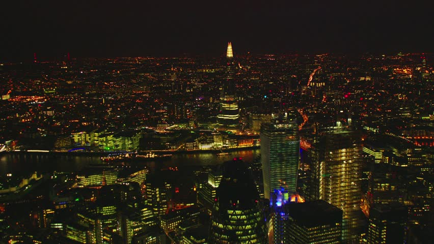 Aerial shot of Central London at night with a view of the Shard, River Thames & The Gherkin