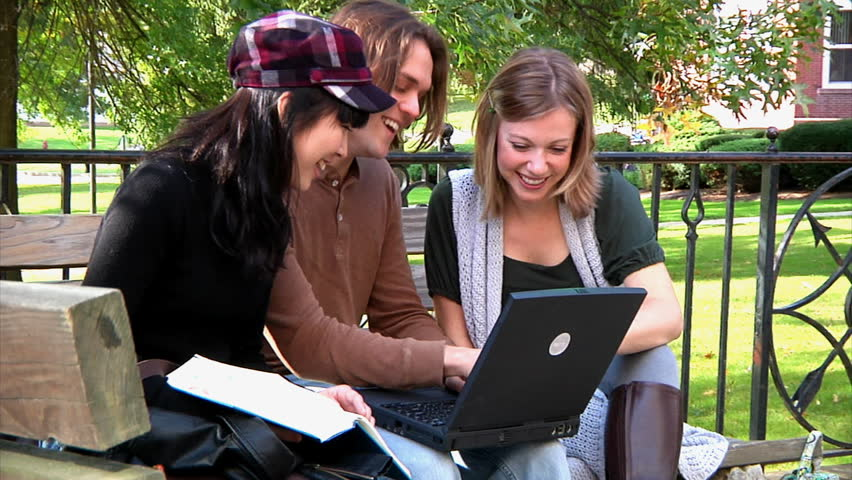 Students meet on campus to socialize and study. - HD stock footage clip
