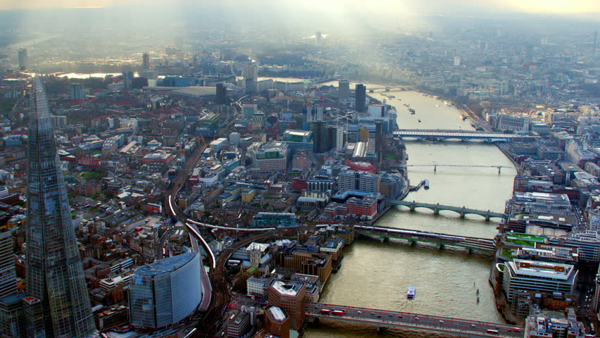 4K Aerial shot of Central London with view of the River Thames, St Paul's Cathedral, Tate Modern, Shard, Cannon Street Station