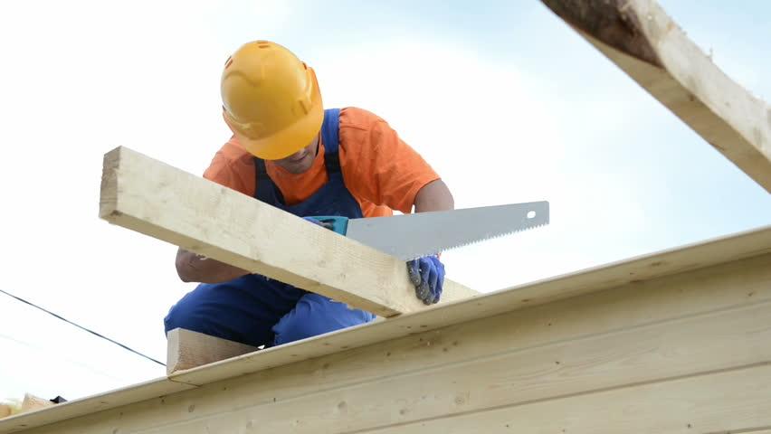 Construction Roofer Carpenter Worker Sawing Wood Board