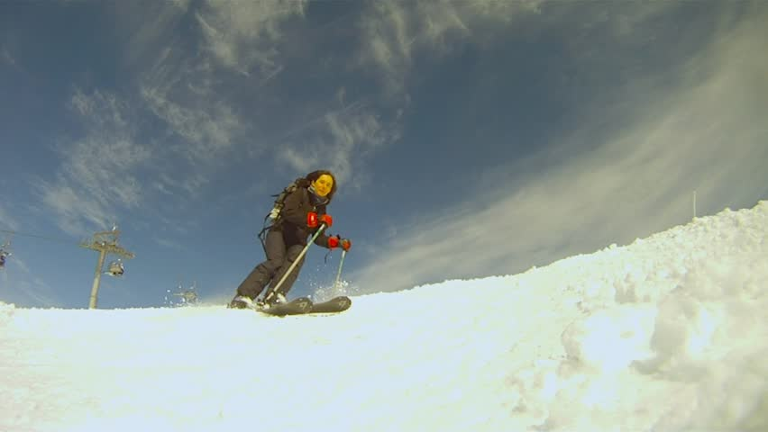 Slow motion of a skier skiing down on the slope stock
