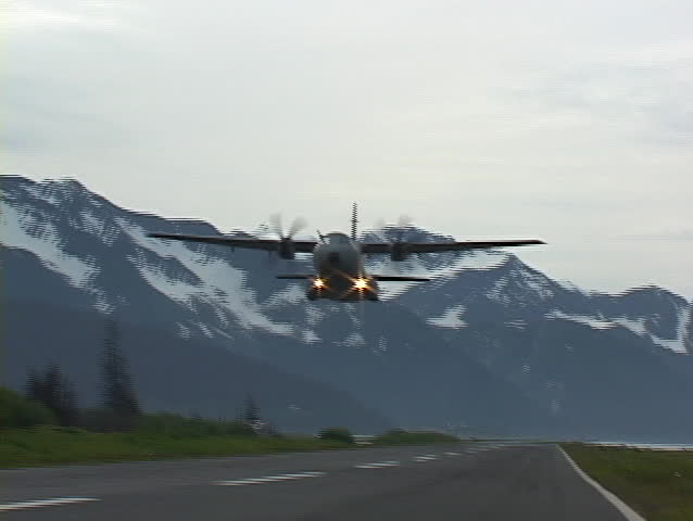 Alaska: Casa C-295 conducts test operations in Alaska 2004. Views from cockpit, tail cam, and fly bys. This is a very high performance aircraft. - SD stock footage clip