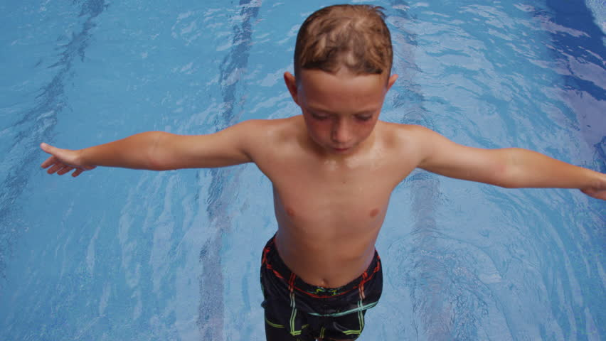 Boy falling into pool, slow motion. Shot on RED EPIC for high quality 4K