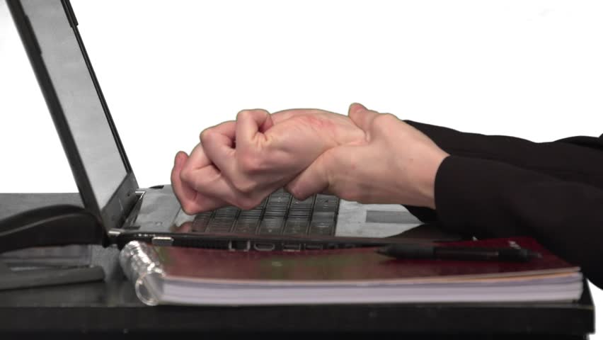 A close up shot of a woman massaging her wrist with Carpal Tunnel Syndrome.