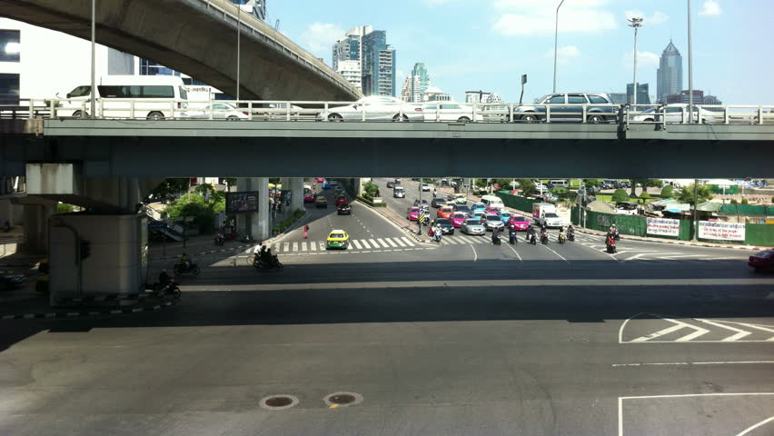 Bangkok, Thailand - November 2013 : Timelapse of busy traffic street at Silom junction in Bangkok - 4K stock video clip
