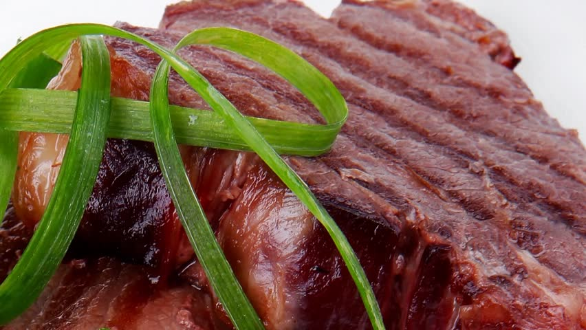 grilled meat beef steaks strips plate with sweet pea and tomatoes 1920x1080 intro motion slow hidef hd