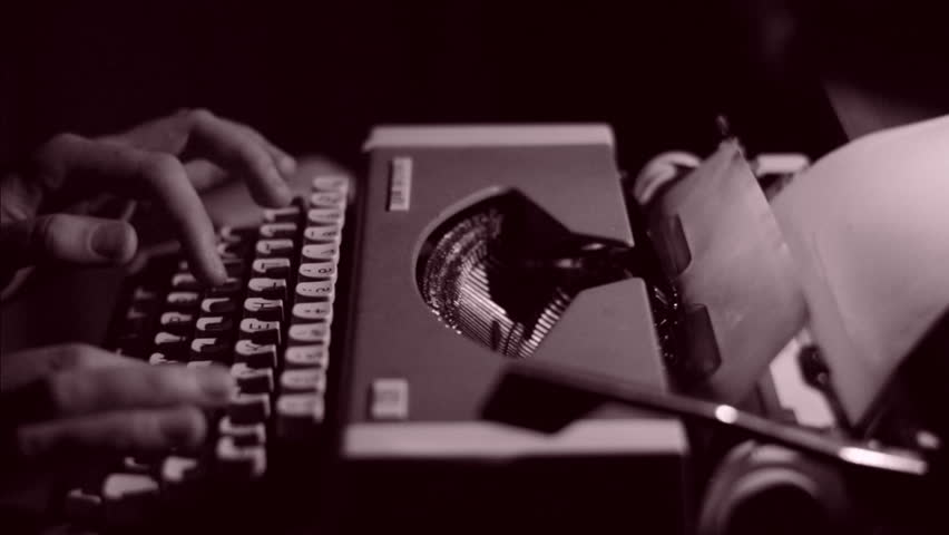 An Author Writing a Book on a Vintage Typewriter, Black and White