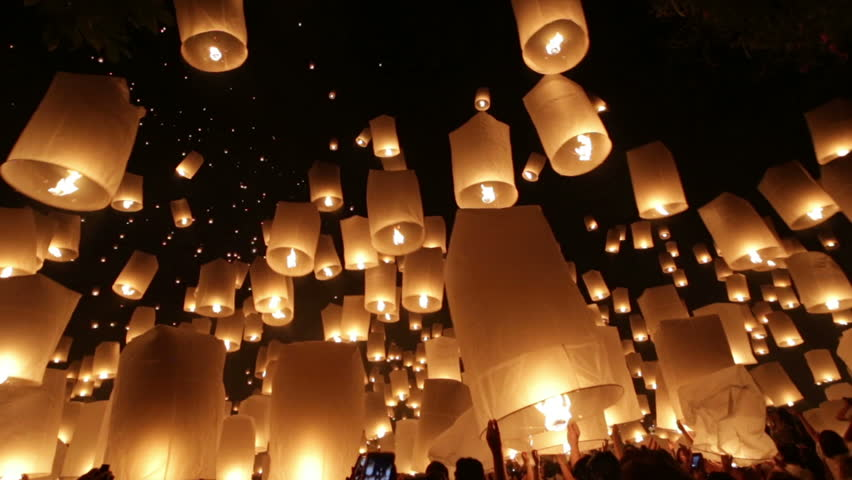 MAE JOE UNIVERSITY, CHIANGMAI, THAILAND - NOV 16: Yi Peng buddhist festival celebration, people launching thousands of flying lanterns in Chiang mai, Thailand on november 16, 2013