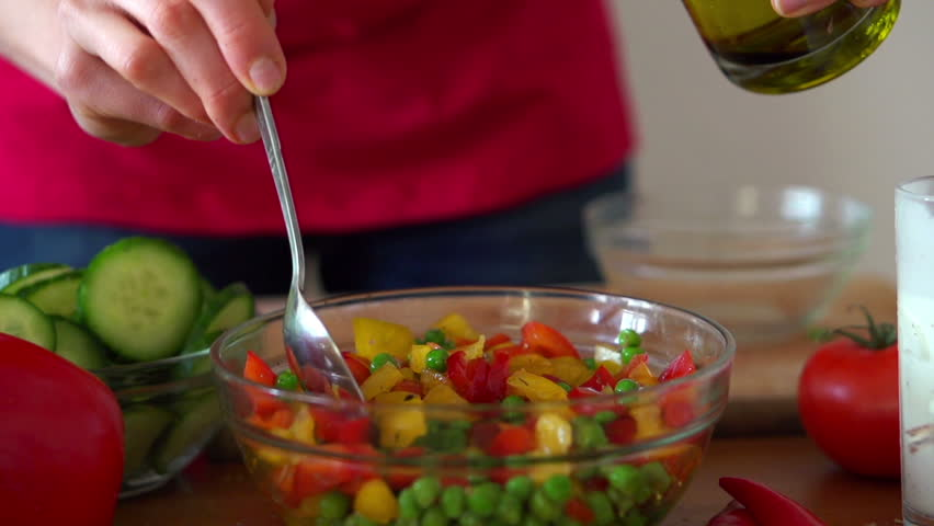 Spoon Mixing Vegetable Salad In Bowl, Super Slow Motion ...