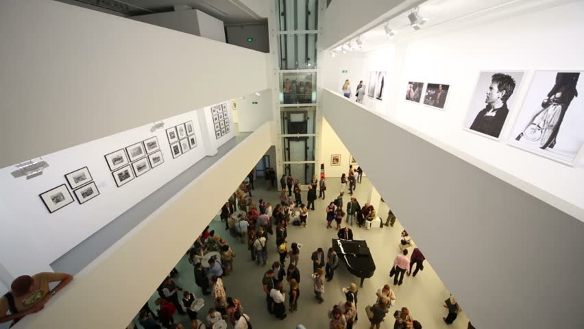 MOSCOW, RUSSIA - AUG 16, 2012: People on first floor and balconies at photo exhibition Atomic Civilization in the Multimedia Art Museum.