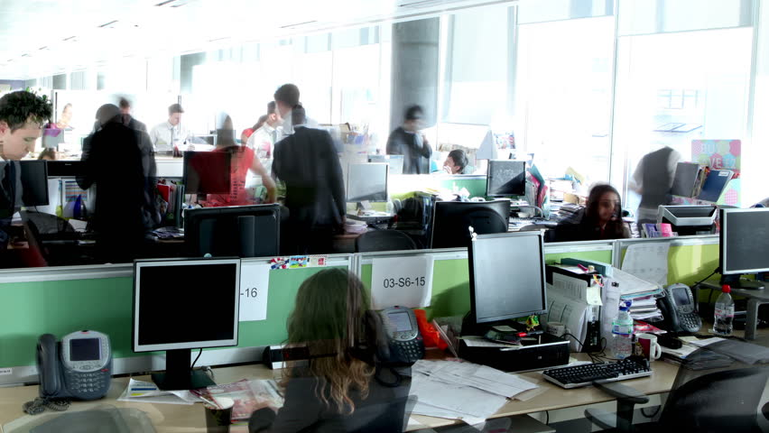 Time lapse of busy city office workers working together in large modern office